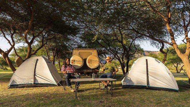 Happ roadtrippers on a camping safari in Tanzania
